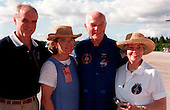 STS-95 Payload Specialist John H. Glenn Jr. (second from right), U.S. Senator from Ohio, poses (left to right) with his son, David, daughter, Lyn, and (far right) his wife, Annie, after landing at Kennedy Space Center's Shuttle Landing Facility aboard a T-38 jet on October 26, 1998. Glenn and other crewmembers flew into KSC to make final preparations for launch..Credit: NASA via CNP