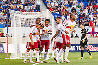 Fabian Espindola (9) of the New York Red Bulls celebrates scoring with teammates during a Major League Soccer (MLS) match against Real Salt Lake at Red Bull Arena in Harrison, NJ, on July 26, 2013.
