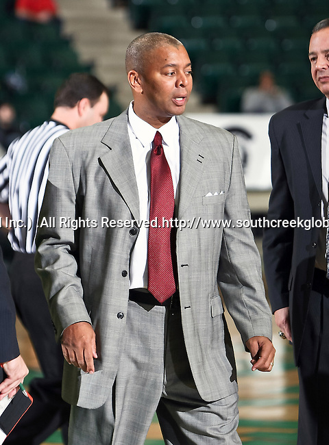 North Texas Mean Green head coach,Johnny Jones, gets ready for a time out in the game between the Texas State Bobcats and the University of North Texas Mean Green at the North Texas Coliseum,the Super Pit, in Denton, Texas. UNT defeated Texas State 85 to 62
