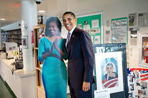 United States President Barack Obama stands by a cut-out picture of First Lady Michelle Obama during a visit to Miami Central High School in Miami, Florida, March 4, 2011. .Mandatory Credit: Pete Souza - White House via CNP
