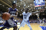 26 November 2014: Duke's Justise Winslow (12) guards an inbounds pass by Furman's Daniel Fowler (35). The Duke University Blue Devils hosted the Furman University Paladins at Cameron Indoor Stadium in Durham, North Carolina in a 2014-16 NCAA Men's Basketball Division I game. Duke won the game 93-54.