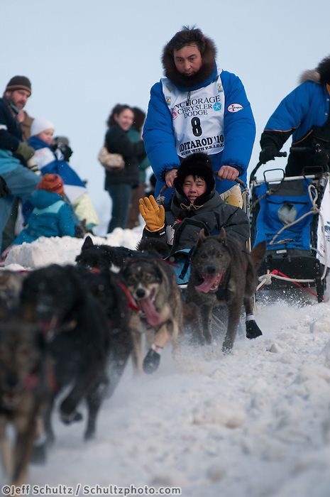 2010 Iditarod Ceremonial Start in Anchorage Alaska musher # 8 JOHN BAKER with Iditarider ERIC BROWER