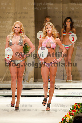 Vivien Meszaros (left) and Dora Gregori (right) attends the Miss Hungary 2010 beauty contest held in Budapest, Hungary on November 29, 2010. ATTILA VOLGYI