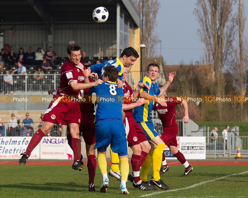 Adam Tann of Chelmsford City gets his head to the corner in a packed Basingstoke penalty area despite Shaun McAuley's attention - Chelmsford City vs Basingstoke Town - Blue Square Conference South Football at Melbourne Park Stadium, Chelmsford - 24/03/12 - MANDATORY CREDIT: Ray Lawrence/TGSPHOTO - Self billing applies where appropriate - 0845 094 6026 - contact@tgsphoto.co.uk - NO UNPAID USE.