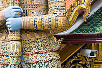 CCTV camera behind a Demon Giant statue in The Grand Palace Complex, Bangkok, Thailand
