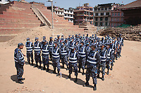 A Nepali police man gives instruction to his squad before an excavation at Kathmandu Durbar Square, Kathmandu, Nepal. May 03, 2015