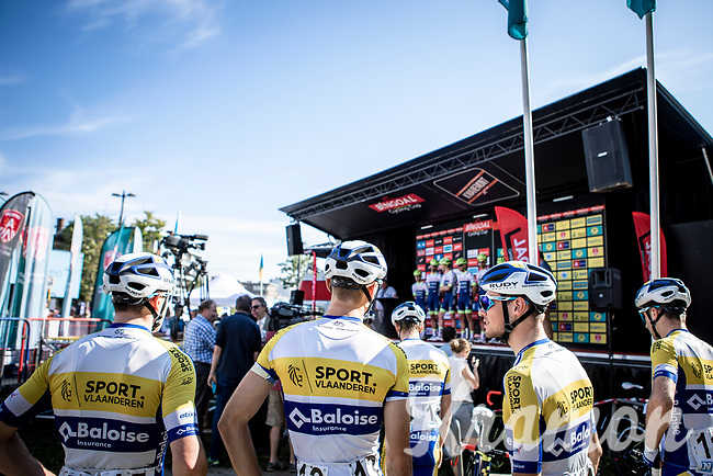 Team Sport Vlaanderen riders awaiting the pre race team presentation. <br /> <br /> 94th Schaal Sels 2019<br /> One Day Race: Merksem  >  Merksem  (UCI 1.1)<br /> ©kramon