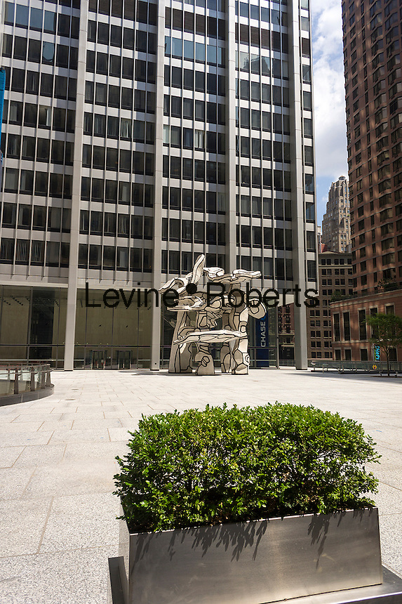 """One Chase Manhattan Plaza with its famous """"Group of Four Trees"""" sculpture by Jean Dubuffet on Rockefeller Plaza is seen in Lower Manhattan in New York on Saturday, August 17, 2013. The landmark building and plaza, owned by JPMorgan Chase, has recently been offered for sale with an estimate of worth of $1 billion. The 60 story building was designed by Skidmore, Owings & Merrill and was completed in 1961. (© Richard B. Levine)"""