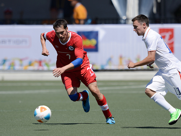 Toronto, ON - Aug 9 2015 -  Dustin Hodgson protects the ball during Canada vs United States in Football 7-a-side at the Parapan Am Fields during the Toronto 2015 Parapan American Games  (Photo: Matthew Murnaghan/Canadian Paralympic Committee)