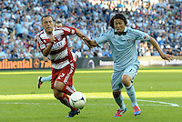 Midfielders Daniel Hernandez (2) FC Dallas and Roger Espinoza (15) Sporting KC chase a loose ball... Sporting KC defeated FC Dallas 2-1 at LIVESTRONG Sporting Park, Kansas City, Kansas.