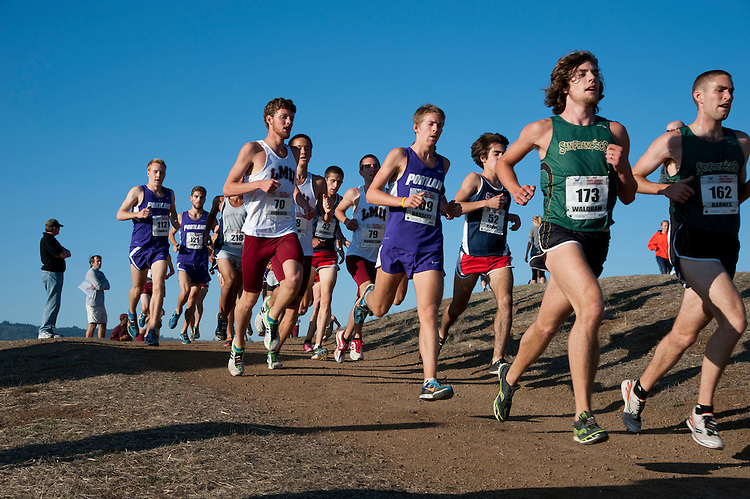 October 29, 2011; Belmont, CA, USA; Portland Pilots runner Scott Fauble (112), Portland Pilots runner David Perry (121), Loyola Marymount Lions runner Kevin Joerger (70), Gonzaga Bulldogs runner Brent Felnagle (42), Loyola Marymount Lions runner Michael Vorgitch (79), Portland Pilots runner Jared Bassett (109), Gonzaga Bulldogs runner Nick Roche (52), San Francisco Dons runner Jason Waldram (173), and San Francisco Dons runner Michael Barnes (162) competes during the WCC Cross Country Championships at Crystal Springs.