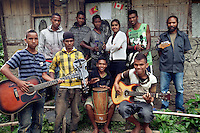 May 3rd, 2012_ LACLUBAR, TIMOR-LESTE_ Young men relax near their house in the Suco of Batara in the mountain town of Laclubar, Timor-Leste.  Photographer: Daniel J. Groshong/The Hummingfish Foundation