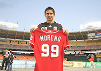 Jaime shows off a baseball shirt presented to him by the Washington Nationals during festivities surrounding the final appearance of Jaime Moreno in a D.C. United uniform, at RFK Stadium, in Washington D.C. on October 23, 2010. Toronto won 3-2.