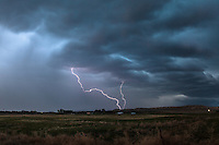 Lightning strike from a colorful blue thunderstorm cloud in Nebraska, May 20, 2014