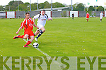 Brian Murphy (dynamos) determined to get to the ball before No3 galway Evan Preston Kelly in the A League Championship in Cahmoneen Dynamos soccer grounds on Sunday....