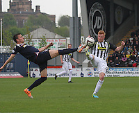 Filip Kiss (left) and Conor Newton go toe to toe in the St Mirren v Ross County Scottish Professional Football League Premiership match played at St Mirren Park, Paisley on 3.5.14.