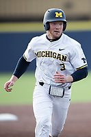 Michigan Wolverines outfielder Miles Lewis (3) runs to third base against the Western Michigan Broncos on March 18, 2019 in the NCAA baseball game at Ray Fisher Stadium in Ann Arbor, Michigan. Michigan defeated Western Michigan 12-5. (Andrew Woolley/Four Seam Images)