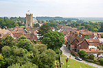 View of building rooftops and church in nucleated village of Orford, Suffolk, England, UK