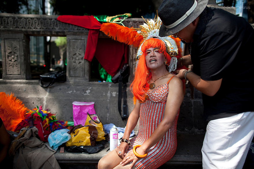 2 June 2012 - Mexico City, Mexico - A transvestite gets dress and made up during the Gay Pride Parade in Mexico City. People take part in the annual gay pride parade in Mexico City (known in Mexico as Marcha del orgullo LGBTQI). Mexico's high-altitude capital city has a huge and active gay population. The increasingly popular Mexico City Gay Pride is helping to heighten the LGBT community's visibility. The LGBT community has been gaining some rights in the first years of the 21st century. On 2003, the Federal Law to Prevent and Eliminate Discrimination was passed. In November 2006, the Law for Coexistence Partnerships was enacted in the Federal District. On March 2010, Mexico became the first Latin American country to allow same-sex marriage by non-judicial means. Photo credit: Benedicte Desrus