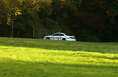 """Bowie, MD - October 23, 2002 -- Prince Georges County Police cruiser patrols the wooded area around Benjamin Tasker Middle School in Bowie, MD on 23 October, 2002.  Tasker is where an unidentified 13 year-old boy was shot by the """"Beltway Sniper"""" on October 7, 2002.<br /> Credit: Ron Sachs / CNP<br /> (RESTRICTION: NO New York or New Jersey Newspapers or newspapers within a 75 mile radius of New York City)"""
