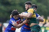 Katetistoti Nginingini and Savelio Ropati tackle Viliami Tolutau Vake. Counties Manukau Premier Counties Power Game of the Week Club Rugby Round 4 game between Pukekohe and Ardmore Marist, played at Colin Lawrie Fields Pukekohe on Friday March 30th 2018.<br /> Ardmore Marist won the game 27 - 21 after leading 13 - 11 at halftime.<br /> Pukekohe Mitre 10 Mega 21 -Trent White, Samu Pailegutu tries, Sione Fifita conversion, Sione Fifita 2, Vilitati Sabani penalties. Ardmore Marist South Auckland Motors 27 - Katetistoti Nginingini, Karl Ropati, Alefosio Tapili tries, Latiume Fosita 3 conversions, Latiume Fosita 2 penalties. <br /> Photo by Richard Spranger.