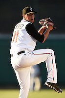 Lansing Lugnuts pitcher Alonzo Gonzalez (11) delivers a pitch during a game against the South Bend Silver Hawks on June 6, 2014 at Cooley Law School Stadium in Lansing, Michigan.  South Bend defeated Lansing 13-5.  (Mike Janes/Four Seam Images)