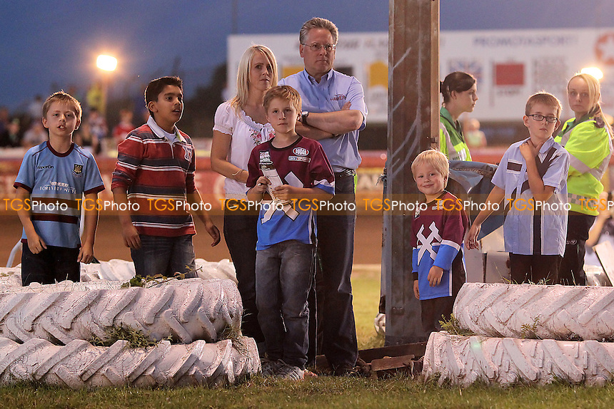 Heat 7: Young fans watch from the centre green - Lakeside Hammers vs Eastbourne Eagles - Sky Sports Elite League Speedway at Arena Essex Raceway, Purfleet - 17/08/12 - MANDATORY CREDIT: Gavin Ellis/TGSPHOTO - Self billing applies where appropriate - 0845 094 6026 - contact@tgsphoto.co.uk - NO UNPAID USE.