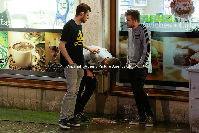 A young man appears to be throwing up in Wind Street, Swansea, Wales  on Mad Friday, Booze Black Friday or Black Eye Friday, the last Friday night before Christmas Day, when traditionally people in the UK go out to celebrate the start of their holidays. Friday 22 December 2017