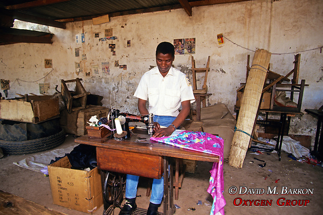Man Sewing In Market