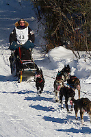 Musher Ken Anderson on Long Lake at the Re-Start of the 2011 Iditarod Sled Dog Race in Willow, Alaska.