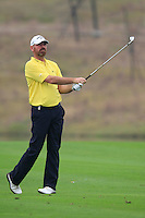 Thomas Bjorn (DEN) plays his 2nd shot on the 11th hole during Friday's Round 2 of the 2014 BMW Masters held at Lake Malaren, Shanghai, China 31st October 2014.<br /> Picture: Eoin Clarke www.golffile.ie