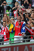 Per Mertesacker of Arsenal lifts the FA Cup after the FA Cup FINAL match between Arsenal and Chelsea at the Emirates Stadium, London, England on 27 May 2017. Photo by David Horn.