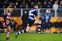 Rhys Priestland of Bath Rugby puts boot to ball. Anglo-Welsh Cup match, between Bath Rugby and Gloucester Rugby on January 27, 2017 at the Recreation Ground in Bath, England. Photo by: Patrick Khachfe / Onside Images