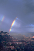 749220018 a spectacular double rainbow forms during a clearing summer monsoon thunderstorm over the geological formations around cape royal on the north rim of grand canyon national park in arizona