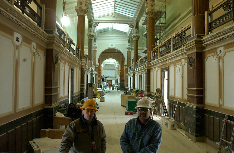 Workers take a break in a wing of National Portrait Gallery and the Smithsonian American Art Museum, during a walk through of the site that is scheduled to open July 1, 2006, after a six year renovation project.