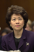 Washington, DC - January 24, 2001 -- Elaine Chao, U.S. Secretary of Labor-designate listens to the Senator's opening remarks during her confirmation hearing before the U.S. Senate Health, Education, Labor and Pensions Committee.<br /> Credit: Ron Sachs / CNP
