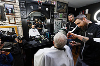 Pictured: Jeremy Corbyn is having his beard trimmed at Big Mel's Barbershop in Carmarthen. Saturday 07 December 2019<br /> Re: Labour Party leader Jeremy Corbyn pre-election campaign in Carmarthen, Wales, UK.