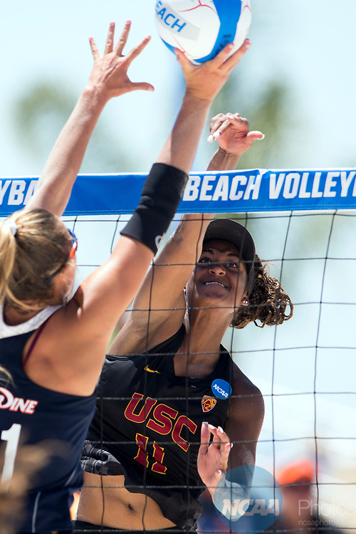 GULF SHORES, AL - MAY 07:  Joy Dennis (11) of the University of Southern California hits the ball past Deahna Kraft (31) of Pepperdine during the Division I Women's Beach Volleyball Championship held at Gulf Place on May 7, 2017 in Gulf Shores, Alabama.The University of Southern California defeated Pepperdine 3-2 to claim the national championship. (Photo by Stephen Nowland/NCAA Photos via Getty Images)