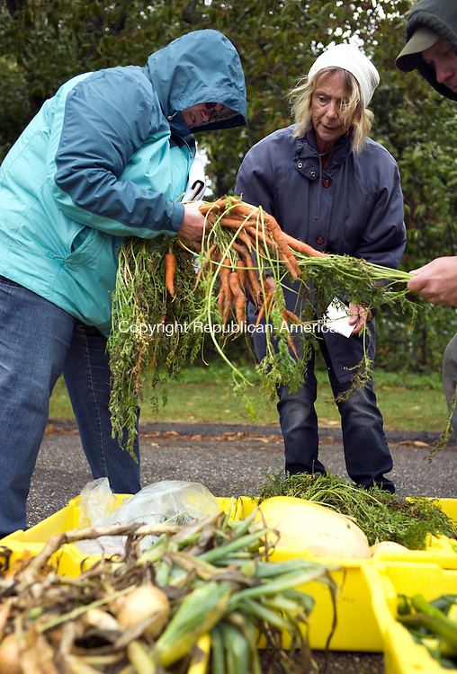 Watertown, CT- 03 October 2015-100315CM02- ​Marsha Grilley, center, of Watertown picks out carrots from<br /> Betty Theriault and Rick Theriault with Farm All Farm of Plymouth during the Watertown Farmers Market on Saturday morning.  Christopher Massa Republican-American