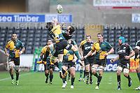 Northampton Saints Jamie Elliott (14) challenges Ospreys Joe Bearman for a high ball. Liberty Stadium, Swansea, South Wales 12.01.14. Ospreys v Northampton Heineken Cup round 5 pool 1 - pIc credit Jeff Thomas photography