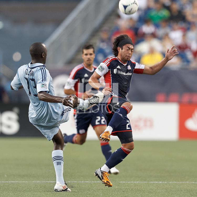 New England Revolution midfielder Lee Nguyen (24) jumps in front of Sporting Kansas City defender Lawrence Olum (13) clearing effort. In a Major League Soccer (MLS) match, Sporting Kansas City defeated the New England Revolution, 1-0, at Gillette Stadium on August 4, 2012.