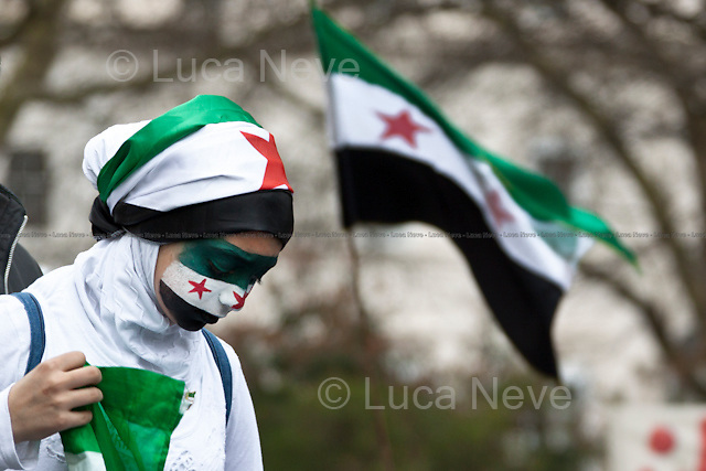 Protester - 2012<br /> <br /> First Anniversary of the Syrian Revolution Demonstration (Syrian People against the President Bashar Al-Assad regime)..London, 17/03/2012. Two different Syrian demonstrations staged in London today. The first rally, started around 1 PM from Paddington Green and it was called globally to commemorate the first anniversary of the Syrian Revolution. Hundreds of people against the President Bashar Al-Assad regime marched through Edgware Road, Park Lane and Hyde Park Corner to end outside the Syrian embassy in Belgrave Square where a Pro-Assad demonstration was already taking place. In fact, around 200 supporters of the President Bashar Al-Assad gathered outside their embassy in support of the regime. Speeches in both English and Arabic were heard from the two different stages built for the occasion. Paul Convoy, the British photographer wounded during the Assad's Government bombing of the city of Homs, gave a speech in support of the Syrian Revolution demonstration.