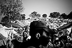 A man walks through a camp for those displaced by the recent earthquake in Petionville, outside  Port-au-Prince, Haiti.