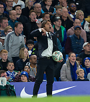 Chelsea Manager Antonio Conte holds onto the ball during the Carabao Cup round of 16 match between Chelsea and Everton at Stamford Bridge, London, England on 25 October 2017. Photo by Andy Rowland.