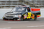 Camping World Truck Series driver Johnny Chapman (38) in action during the NCWTS Winstar World Casino 400 race at Texas Motor Speedway in Fort Worth,Texas.