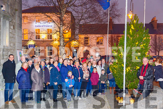 Light To Remember: Canon Declan O'Connor, on right  blessing the Light to Remember Tree at St. John's Arts centre on Sunday evening last.