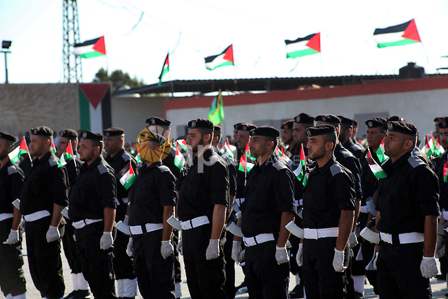 Graduating Hamas's police officers stand to attention during a ceremony in Gaza City on July 05, 2012. Hamas has governed the Gaza Strip since June 2007, after it won a majority of seats in the Palestinian Parliament in the January 2006 Palestinian parliamentary elections, and then defeated the Fatah political organization in a series of clashes. Photo by Ashraf Amra