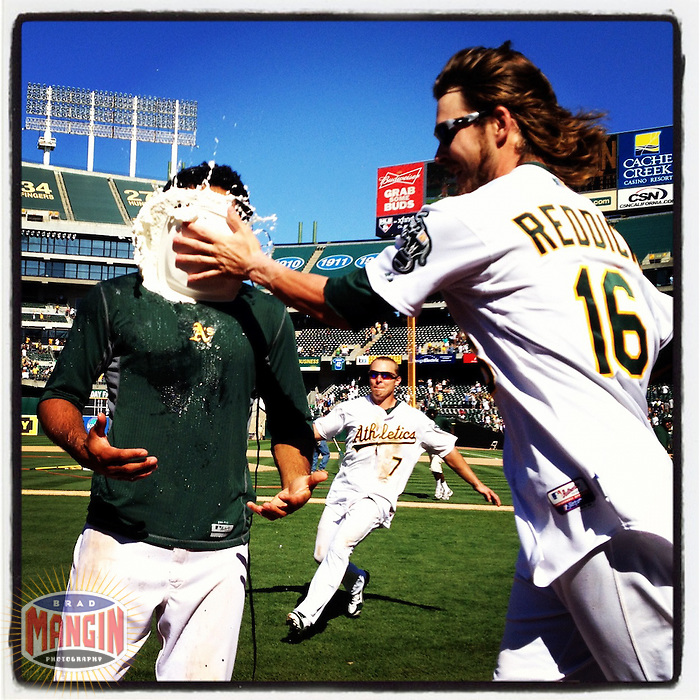 OAKLAND, CA - JULY 22: Instagram of Coco Crisp of the Oakland Athletics getting a whipped cream pie in the face from teammate Josh Reddick after the game against the New York Yankees at O.co Coliseum on Sunday, July 22, 2012 in Oakland, California. Photo by Brad Mangin