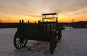 The silhouette of a wagon at Wagon Hill Farm in Durham, New Hampshire USA during the winter months