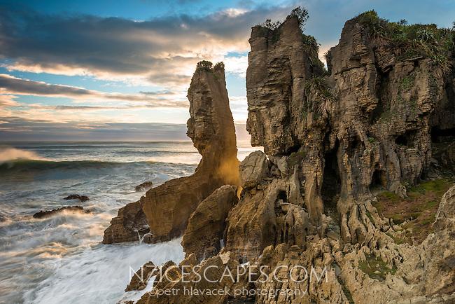 Sunset with eroded Pancake Rocks, limestone formations in Punakaiki, Paparoa National Park, West Coast, New Zealand
